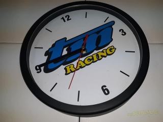 c772dbff647 Hodiny TM Racing logo